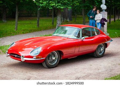Arkhangel'skoye, Russia - July 2019: The British sports car Jaguar E-type is parked on the gravel road