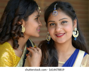 ARKHET BAZAR, NEPAL - MAY 14, 2019: Two young Nepali Chhetri women with forehead jewelry and earrings pose for the camera during a traditional Hindu wedding, on May 14, 2019.