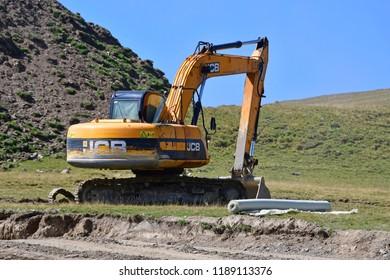 "Arkhyz, Russia, Caucasus, September, 06, 2018. JCB excavator at the construction site of the ski resort ""Romantic"" in Arkhyz"