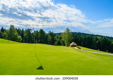 ARLAMOW GOLF COURSE, POLAND - AUG 3, 2014: beautiful golf play area on sunny summer day in Arlamow Hotel. This luxury hotel was owned by Poland's government and is located in Bieszczady Mountains.