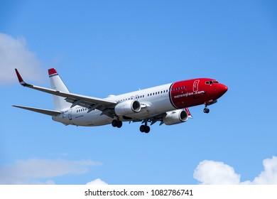Arlanda, Stockholm, Sweden - April 27, 2018: Norwegian Air Shuttle ASA, Boeing 737-8JP fly by and landing at Stockholm Arlanda Airport / ARN. Jet aircraft / plane.