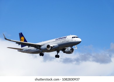 Arlanda, Stockholm, Sweden - April 27, 2018: Deutsche Lufthansa AG, Airbus A320-214 fly by in white clouds and blue sky, landing at Stockholm Arlanda Airport / ARN. Jet aircraft / plane.