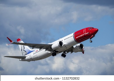 Arlanda, Stockholm, Sweden - July 10, 2018: Norwegian Air Shuttle ASA, Boeing 737 MAX 8 take off in white clouds and blue sky at Stockholm Arlanda Airport / ARN. Jet aircraft / plane.