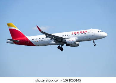 Arlanda, Stockholm, Sweden - May 8, 2018: Iberia, Airbus A320 -216 fly by in blue sky and landing at Stockholm Arlanda Airport / ARN. Jet aircraft / plane.