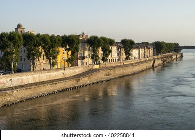 Arles (Bouches-du-Rhone, Provence-Alpes-Cote-d'Azur, France): cityscape along the river at evenng