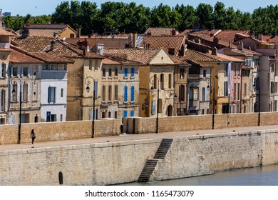 Arles. France. 06.16.12. Old buildings by the River Rhone in the old town of Arles in Provence in the South of France.