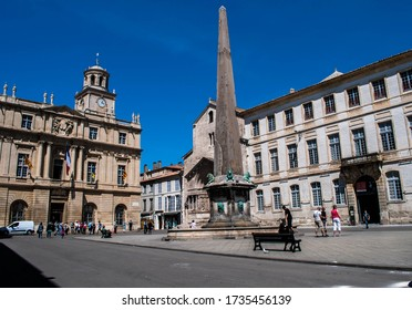 Arles, France, 12 May 2014, Place de la République with the town hall, the obelisk and the Saint-Trophime church.