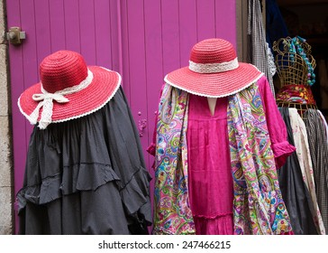 ARLES, FRANCE - APRIL 29, 2013: Vintage style clothes on display at the entry to boutique. Narrow streets near the famous amphitheatre of Arles have many unique boutiques and souvenir shops.