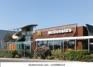 Arles, France - July 4, 2018: McDonald's restaurant in France. McDonald's is the world's largest chain of hamburger fast food restaurants