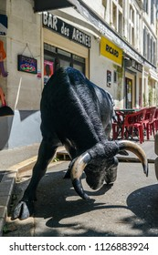 Arles, France - June 16th, 2018: Fake bull on the streets of Arles, famous for its bullring in the arena held twice a year during Feria d'Arles