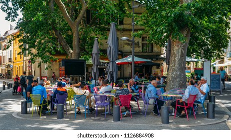 Arles, France - June 16th, 2018: Cafe and restautants in the old town of Arles in Provence in the South of France