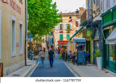 ARLES, FRANCE, JUNE 21, 2017: View of a narrow street in the center of Arles, France