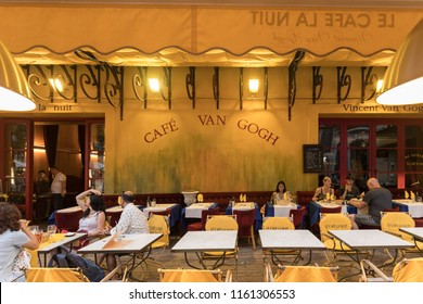 Arles, France - June 24, 2017: Cafe Van Gogh at Place du Forum in Arles. Provence, France. This is the same Cafe Terrace that Vincent van Gogh painted in 1888 and is now a landmark tourist attraction.