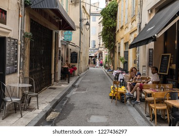 Arles, France - June 24, 2017: Cafe and restautants in the old town of Arles in Provence in the South of France.