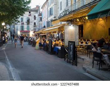 Arles, France - June 24, 2017: People sitting at a cafe in Place du Forum, Arles, Provence, France.