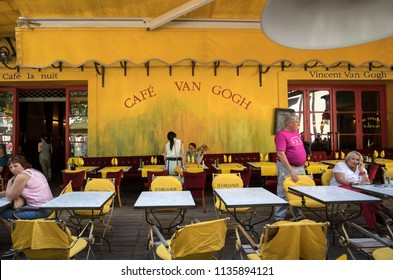 Arles, France - June 27, 2017: Cafe Van Gogh at Place du Forum in Arles. Provence, France. This is the same Cafe Terrace that Vincent van Gogh painted in 1888 and is now a landmark tourist attraction.