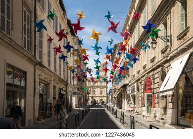 Arles, France - June 27, 2017: Street decorated with colorful stars in Arles, Provence. France