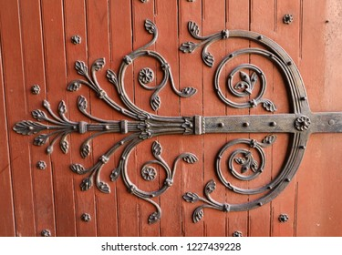 Arles, France - June 27, 2017: Decorated hinges in the door of Saint Trophime Cathedral in Arles, France. Bouches-du-Rhone,  France