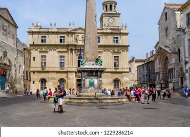 Arles, France - May 12, 2011: Tourists and locals wait for Prince Albert of Monaco to leave the city hall building in the Place de La Republique in Arles, France.