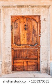 Arles, France, September 23, 2018: Vintage olive wooden door with carvings and decor