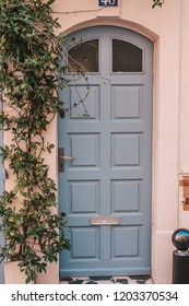 Arles, France, September 23, 2018: Vintage gray wooden door with carvings and decor
