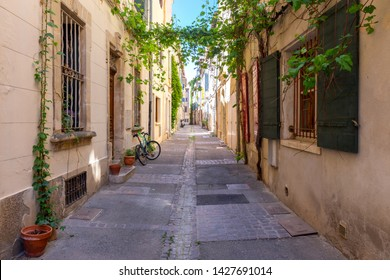 Arles. Old narrow street in the historic center of the city.