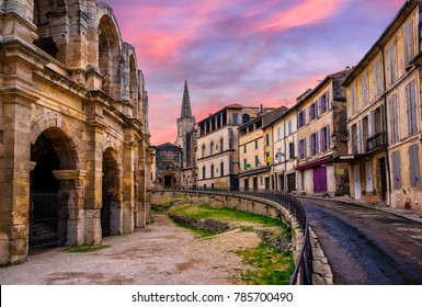Arles Old Town and roman amphitheatre, Provence, France in dramatic sunset light
