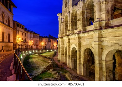 Arles Old Town and roman amphitheatre, Provence, France at late evening light