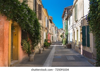 Arles in the south of France, typical paved side street of the city center