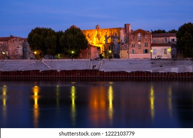 Arles, view to historic town from the river. Twilight, Arles, Provence-Alpes-Cote d'Azur, France.
