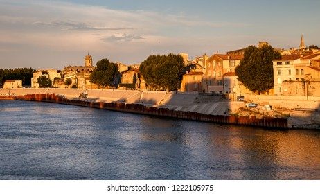 Arles, view to historic town from the river. Golden hours, Arles, Provence-Alpes-Cote d'Azur, France.