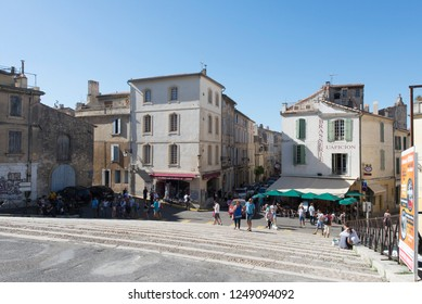 Arles/France - August 10 2016: Rond-Point des Arènes street, in the old city of Arles, France. Arles is a city and commune in the south of France.