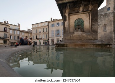 Arles/France - August 7 2016: Public fountain in Place de la Republique square, in the old city of Arles, France. Arles is a city and commune in the south of France.