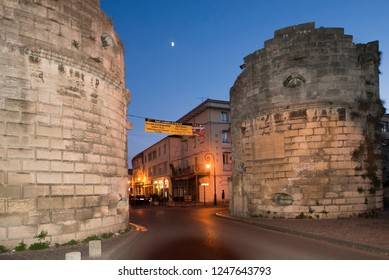 Arles/France - August 9 2016: The remains of the city ramparts in the old city of Arles, France, at the Rue de la Cavalerie street. Arles is a city and commune in the south of France.