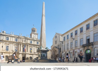 Arles,France-august 14,2016:people stroll in the square where the city hall and the obelisk of Arles are located during a sunny day