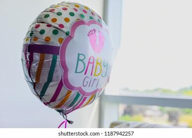 Arlington Heights, IL / USA - 09-10-2018 - closeup of baby girl helium balloon in hospital room no people