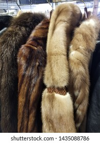 Arlington Heights, Illinois / USA - February 20 2019: Shown here is a rack of nice fur coats at the resale shop.