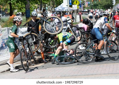 ARLINGTON JUNE 5: Cyclists crash in the men's ¾ race at the Armed Forces Cycling Classic on June 5, 2021 in Arlington, VA