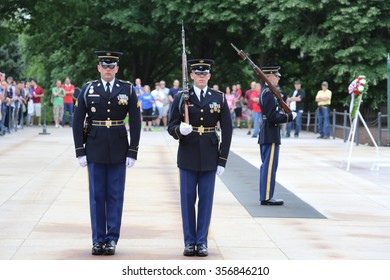 """Arlington National Cemetery. 5/9/2015. Members of the U.S. Army 3rd Infantry Regiment """"The Old Guard"""" present the changing of the guard at the Tomb of the Unknowns."""