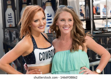 Arlington, Texas / USA - August 29, 2015: Portrait of a Dallas Cowboys Dancer and Her Friend Outside of AT&T Stadium in Arlington, TX