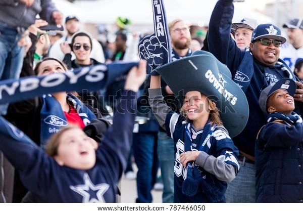 Arlington, Texas / USA - December 19, 2015: Young Dallas Cowboys Fan in a Big Cowboys Hat Outside AT&T Stadium