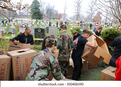 Arlington, VA - December 12 2015: Cadets from the United States Air Force Auxiliary Civil Air Patrol pass out holiday wreaths to the public during Wreaths Across America at Arlington National Cemetery