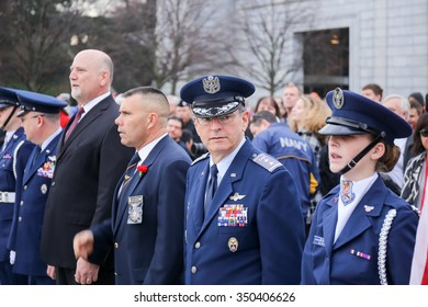 Arlington, VA - December 12 2015: Major General Joseph Vazquez, Civil Air Patrol National Commander, inspects the cadet honor guard for Wreaths Across America