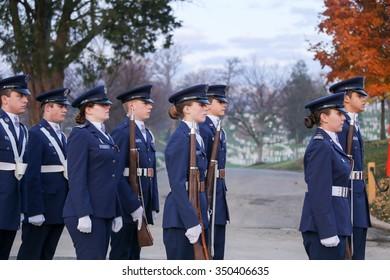 Arlington, VA - December 12 2015: A cadet honor guard from Civil Air Patrol marches across Arlington National Cemetery
