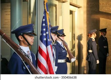 Arlington, VA - December 12 2015: A cadet honor guard from Civil Air Patrol awaits the arrival of the trucks carrying holiday wreaths at Arlington National Cemetery