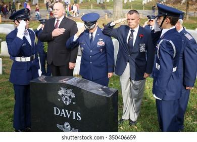 Arlington, VA - December 12 2015: Civil Air Patrol National Commander, Major General Joseph Vazquez, salutes a veterans gravesite during Wreaths Across America