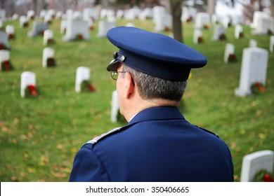 Arlington, VA - December 12 2015: Civil Air Patrol National Commander, Major General Joseph Vazquez, looks out at the holiday wreaths on the headstones of veterans at Arlington National Cemetery