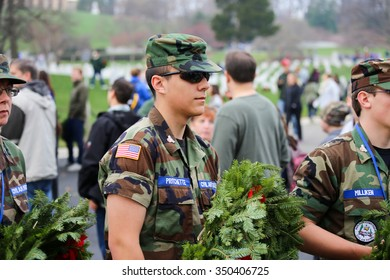 Arlington, VA - December 12 2015: A cadet from the United States Air Force Auxiliary Civil Air Patrol prepares to hand out holiday wreaths to the public during Wreaths Across America