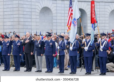 Arlington, VA - December 12 2015: Members of the United States Air Force Auxiliary Civil Air Patrol salute as trucks from Wreaths Across America carrying wreaths arrive at Arlington National Cemetery