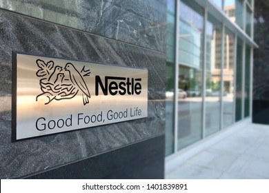ARLINGTON, VA - MAY 19, 2019: NESTLE USA - entrance to headquarters building with sign